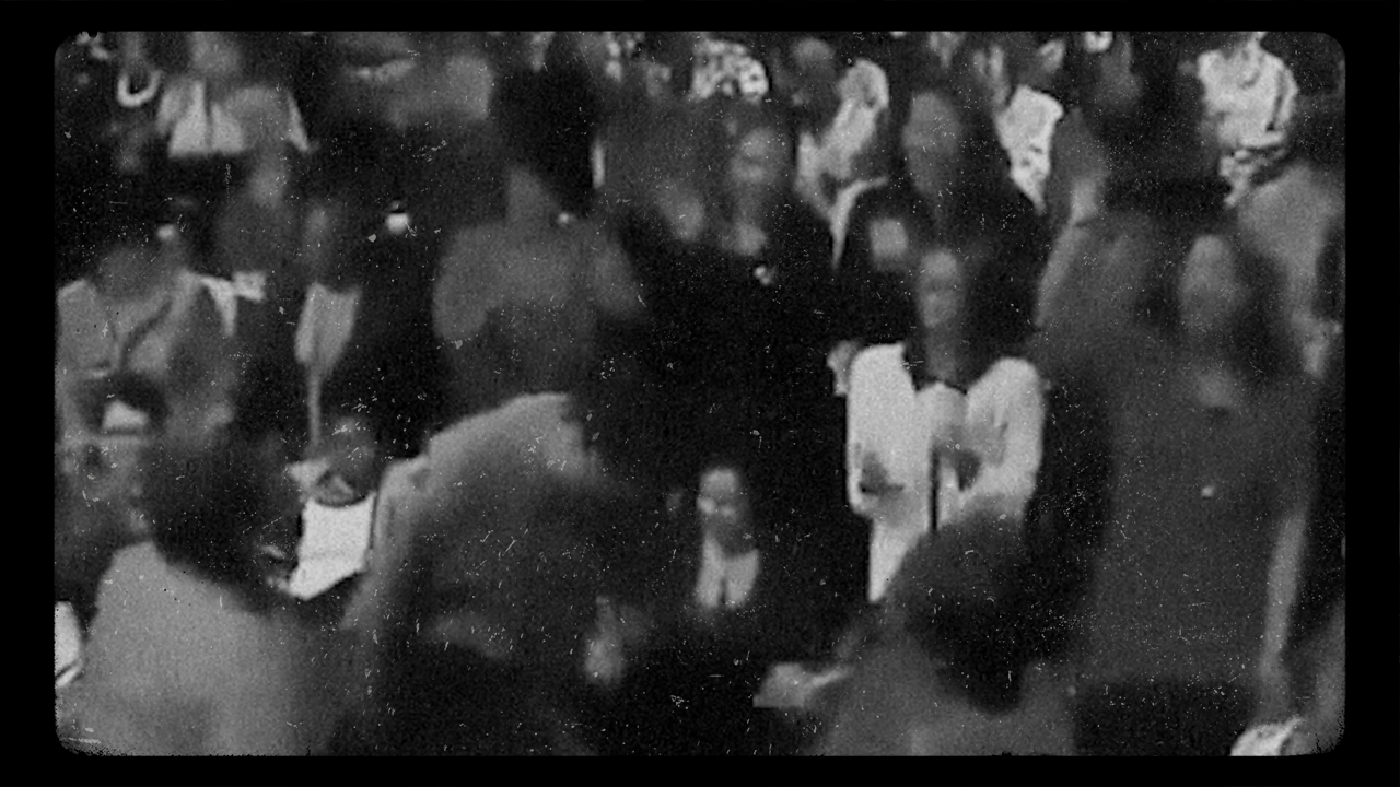 Blurry image of Black worshippers at church