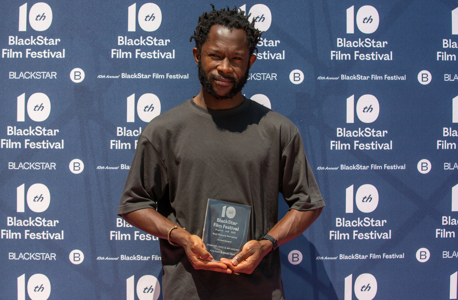 Eyimofe co-director Arie Esiri poses with the award for Best Feature Narrative at the 2021 BlackStar Film Festival